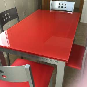 For sale: Red glass table and 4 chairs